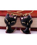 pair of earrings with a little black cat, and vintage rhinestones