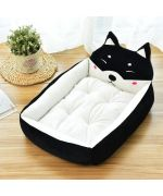 Soft bed for dog and black cat